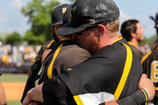 Southern Miss Golden Eagles' Jake Sandlin (left) and Clay Tageany (right) embrace each other after winning the C-USA tournament against Rice University at Pete Taylor Park in Hattiesburg, Mississippi on May 29, 2016.