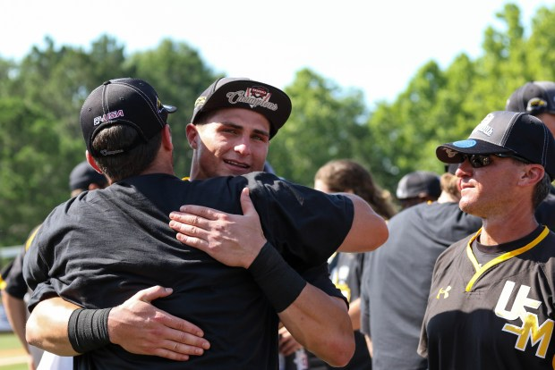 Southern Miss Golden Eagles' Daniel Keating embraces one of his teammates after winning the C-USA tournament against Rice University in Hattiesburg, Mississippi on May 29, 2016.