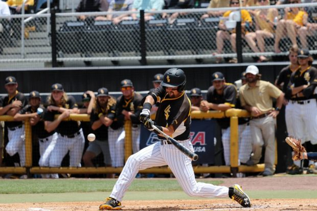 Southern Miss Golden Eagles' Tim Lynch swings to hit the ball at the C-USA tournament against Rice University at Pete Taylor Park in Hattiesburg, Mississippi on May 29, 2016.