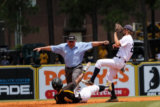 The umpire announces Southern Miss Golden Eagles' Tracy Hadley safe after sliding into second base at the C-USA tournament against Rice University at Pete Taylor Park in Hattiesburg, Mississippi on May 29, 2016.