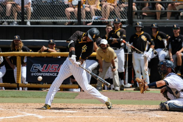 Southern Miss Golden Eagles' Jake Sandlin swings to hit the ball at the C-USA tournament against Rice University at Pete Taylor Park in Hattiesburg, Mississippi on May 29, 2016.