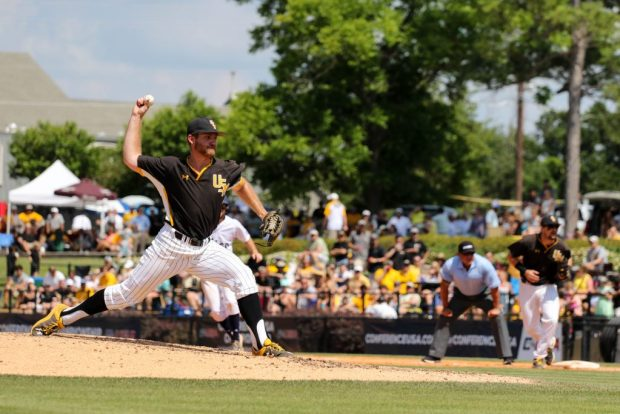 Southern Miss Golden Eagles' Nick Johnson pitches the ball in the C-USA tournament against Rice University at Pete Taylor Park in Hattiesburg, Mississippi on May 29, 2016.