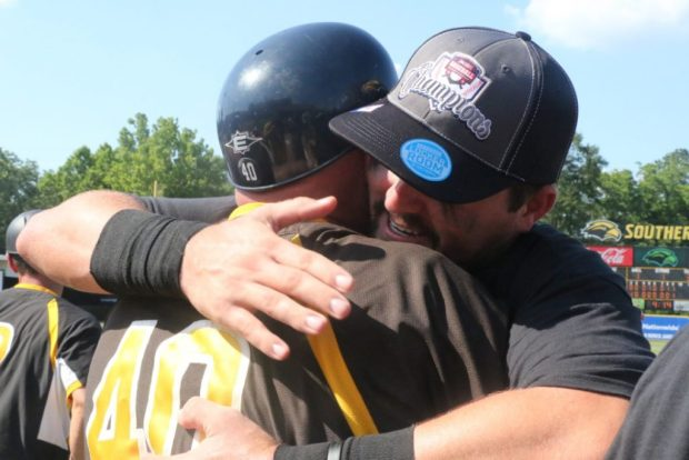 Coach Scott Berry and Tim Lynch hug each other after their 3-2 victory over Rice on May 29.