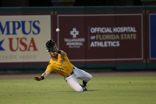 Hunter Slater catches a pop fly against Florida State University at the Tallahassee Regional on June 4, 2016.