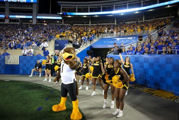 Seymour poses with Southern Miss cheerleaders at the Southern Miss vs. Kentucky football game on Sunday, Sep 4th, 2016. ( Student Printz/Fadi Shahin)