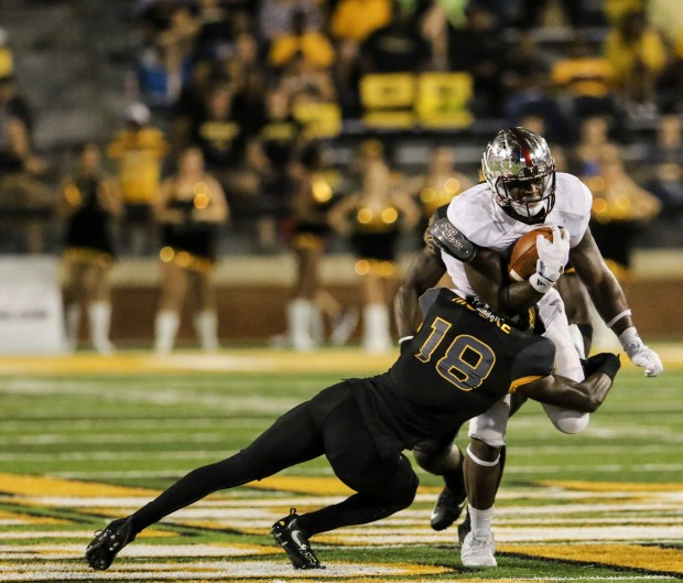 Southern Miss defensive back Tarvarius Moore (18) makes a successful tackle against a Troy player in Hattiesburg on September 17, 2016. (Student Printz/ Hunt Mercier)