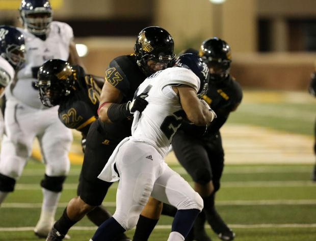 Defensive lineman LaDarius Harris makes a tackle on Rice running back Samuel Stewart during Southern Miss' 44-28 victory on Oct. 1.
