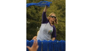 Woman aboard a float hurls beads at open hands during the Carnival on the Coast in Biloxi, MS on Feb. 28.