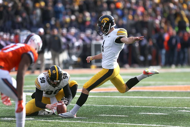 Iowa kicker Marshall Koehn kicks for an extra point in Memorial Stadium on Saturday, Nov.15, 2014 in Champaign, Illinois. The Hawkeyes defeated the Fighting Illini 30-14. (The Daily Iowan/Valerie Burke)