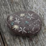 Embroidered felt stones