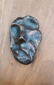 Donald Wells (1929 -2014) Unique bronze mounted on wood for hanging on the wall. Signed D Wells on the reverse of the wood. The bronze has maximum dimensions of 10 cm by 7 cm and the wood is 20 cm by 13 cm. Price £450