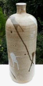 Bill Marshall: 43cm tall stoneware vase with glaze splashes.
