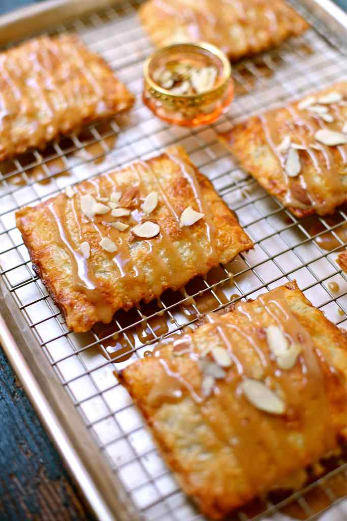 Pies on a baking rack with sliced almond