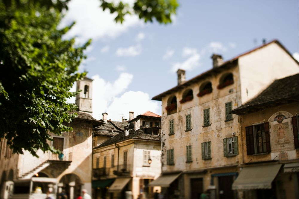 Italian lake weddings - beautiful Piazza Motta at Lake Orta, a perfect meeting point before or after the wedding ceremony in the Church of Santa Maria Assunta. Lake Orta Wedding photographer & Videgrapher