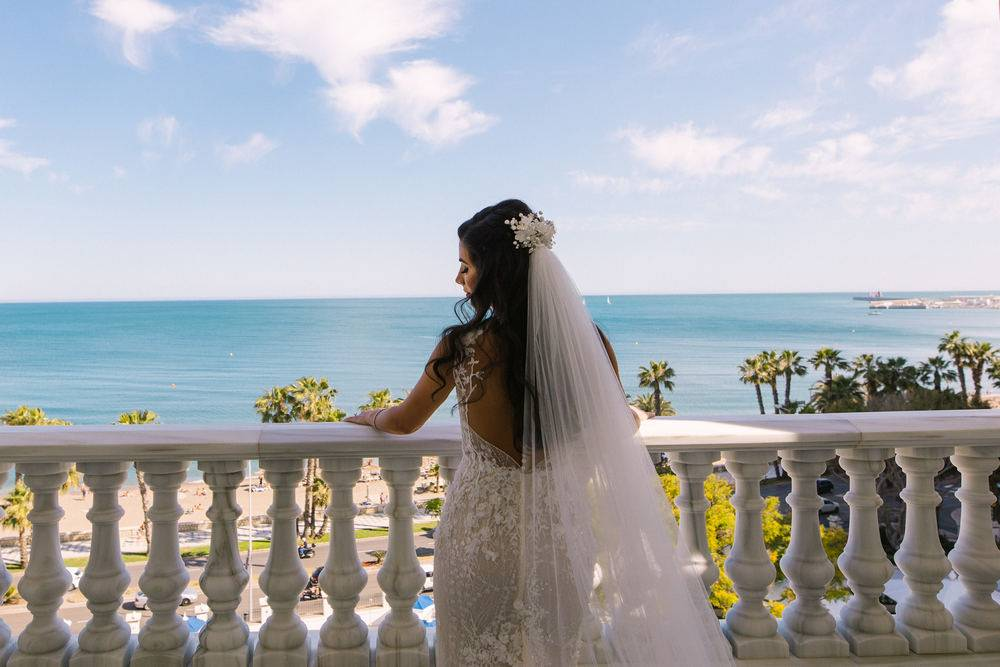 Bride overlooking Andalusian sea before leaving for Spain Wedding Venue in Malaga.