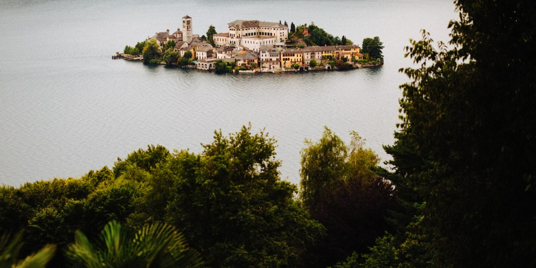 A beautiful view towards the San Giulio Island captured by Lake Orta photographer