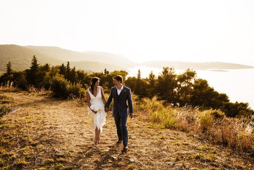 A wedding couple enjoying their photo session during the golden hour on Vis Island
