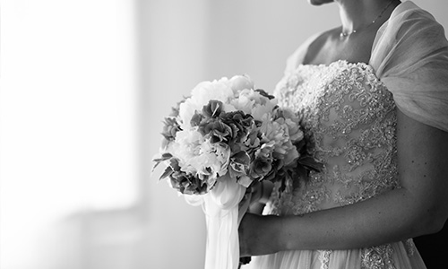 Wedding Coordinator London - bride holding flowers
