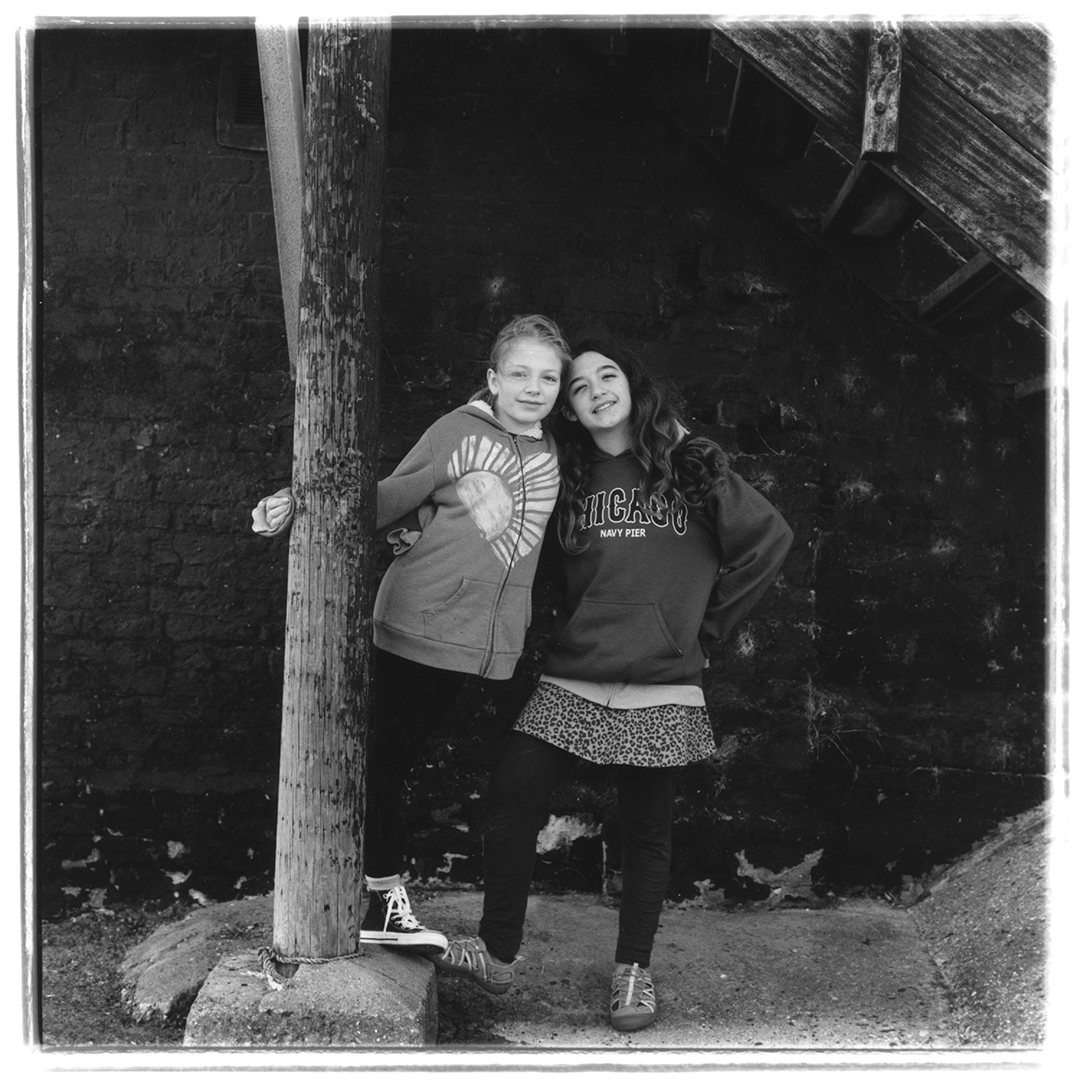Film photograph of Natalie and Kaylee in Leigh on Sea.  Natalie and Kaylee are cousins.  Photographed on a Rolleiflex 2.8e with Ilford hp5 120 film.