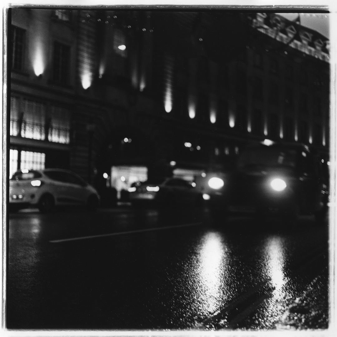 Film photograph of a london cabbie driving near Oxford Circus in London UK.  Photographed with a Rolleiflex 2.8e and my favorite film Ilford hp5.