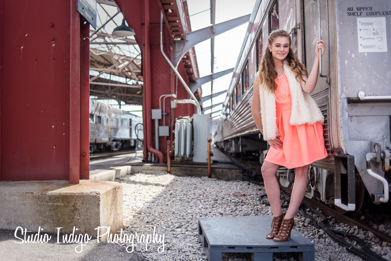 Wide shot of Sarah showing more of the location.  Senior portrait photo shoot at Union Station using natural light and small reflector.  Nikon D750 and Nikon 35mm 2.0D lens.