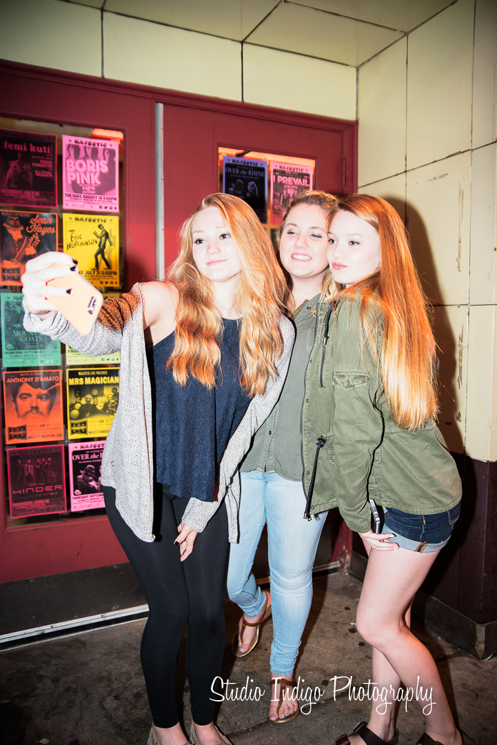 All 3 ladies posing for a selfie in this stylish senior portrait.  On camera flash on manual setting created the high key fashion look.