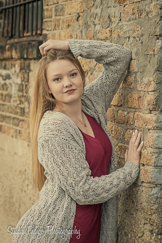 This is one of our go-to senior picture poses.  By positioning the arms like this we create triangles and negative space  and an overall nice shape.