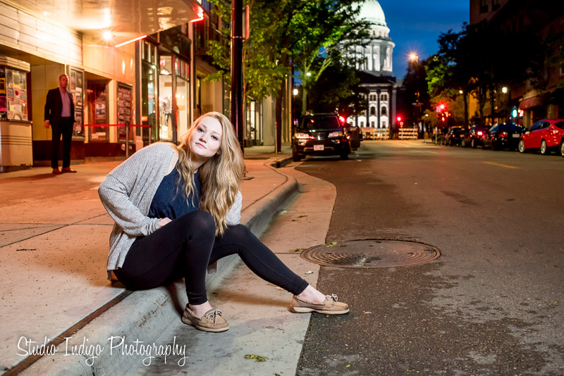 Love this senior portrait sitting on the curb in dowtown madison at night.  All the funky lights from the capital rotunda and theater marquee.  Still using the speedlite with small softbox for the key light.  Love Serena's pose which she came up with on her own.  Later in the shoot your high school senior model is usually getting into the flow and is doing their own poses.