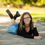High school senior portrait of girl in a lying down pose