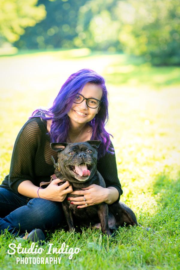 Sitting senior girl portrait at UW arboretum with her pet dog