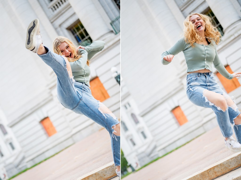 Senior portrait with subject doing a karate kick with a natural laugh.