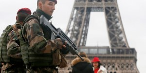 """French soldier patrol near the Eiffel Tower in Paris as part of the highest level of """"Vigipirate"""" security plan after a shooting at the Paris offices of Charlie Hebdo January 9, 2015. The two main suspects in the weekly satirical newspaper Charlie Hebdo killings were sighted on Friday in the northern French town of Dammartin-en-Goele where at least one person had been taken hostage, a police source said. REUTERS/Gonzalo Fuentes (FRANCE - Tags: MILITARY CRIME LAW POLITICS)"""
