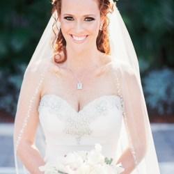 wedding style curly red hair dark eyeshadow full eyelashes
