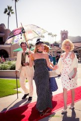 Glamorous staff member Susan Leonard spends time with the celebrities at the Hollywood Fashion Contest during the 2015 Bing Crosby Opening Day at Del Mar.