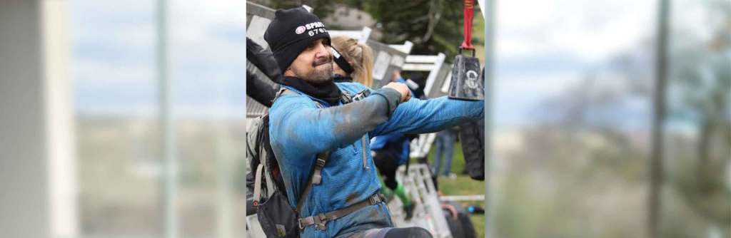 Ceo and Founder of Zipi, Jesse Garcia, participates in a Spartan Race