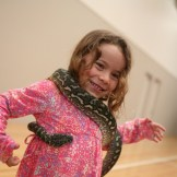 My daughter Emily encircled by a friendly snake