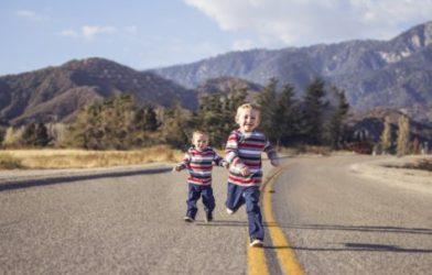 Siblings running in street