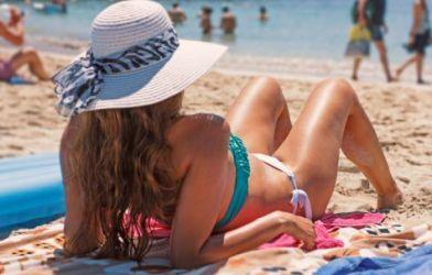 Woman in bikini laying out at beach