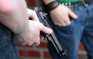 Person holding a handgun