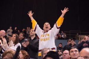 Hockey fan cheering