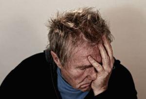 Upset, tired elderly man