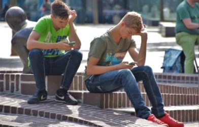 Young adults looking at smartphones