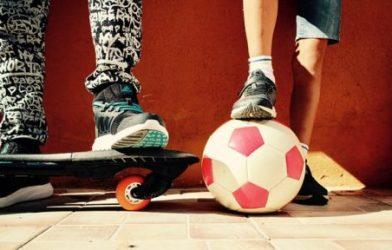 Boys with soccer ball, skateboard