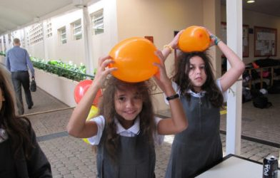 Girls with balloon static friction