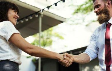 Handshake between man and woman at meeting