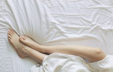 Person laying in bed