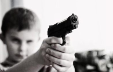 Child holding a gun
