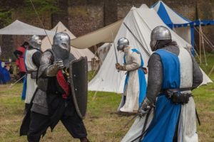 Medieval knights hold a sword fight reenactment