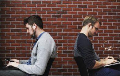 Men looking at screens