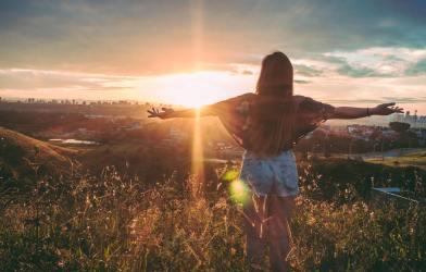 Woman enjoying sunset over city